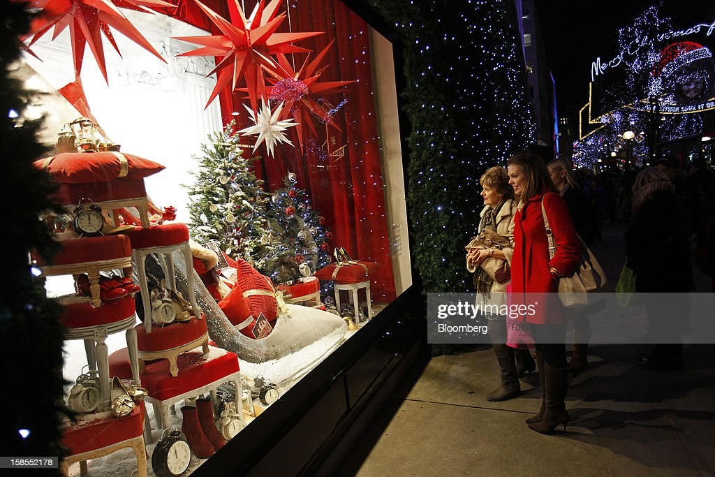 Pedestrians look at the Christmas window display of the Selfridges department store, operated by Selfridges Plc, on Oxford Street in London, U.K., on Monday, Dec. 17, 2012. Retailers are relying on Christmas sales to help rescue a year when high unemployment and the debt crisis have blighted spending. Photographer: Simon Dawson/Bloomberg via Getty Images