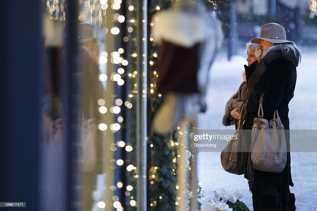 Pedestrians look in the window of a fashion store in Gstaad, Switzerland, on Saturday, Jan. 19, 2013. Options traders are pushing the cost of bearish wagers on Swiss shares to the lowest level in almost seven years amid optimism a decline in the franc versus the euro will benefit the nation's exporters. Photographer: Valentin Flauraud/Bloomberg via Getty Images