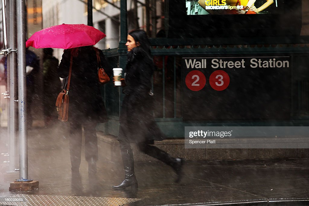 Pedestrians make their way through sleet and snow during the morning commute on January 28, 2013 in New York City. Following some of the coldest weather this winter, temperatures are expected to gradually warm during the week in New York.