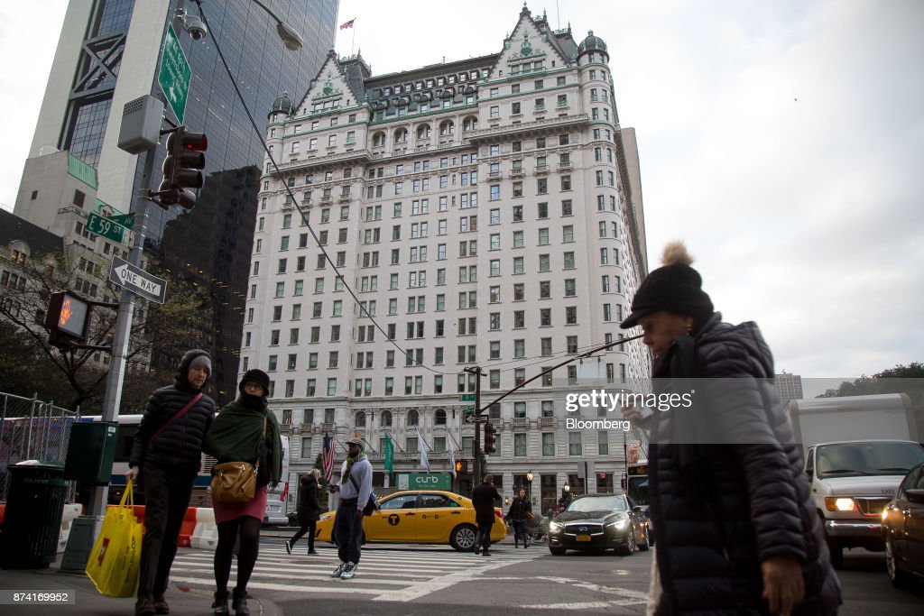 Pedestrians near the Plaza Hotel in New York, U.S., on Monday, Nov. 13, 2017. Billionaire Saudi Prince Alwaleed bin Talal has long been associated with New York's iconic Plaza Hotel, ever since he bought out Donald Trump over two decades ago. Photographer: Michael Nagle/Bloomberg via Getty Images