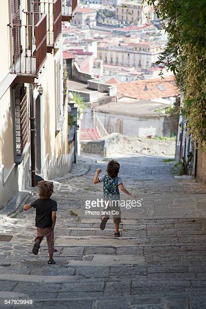 Pedestrians on a path that descends from Castel Sa