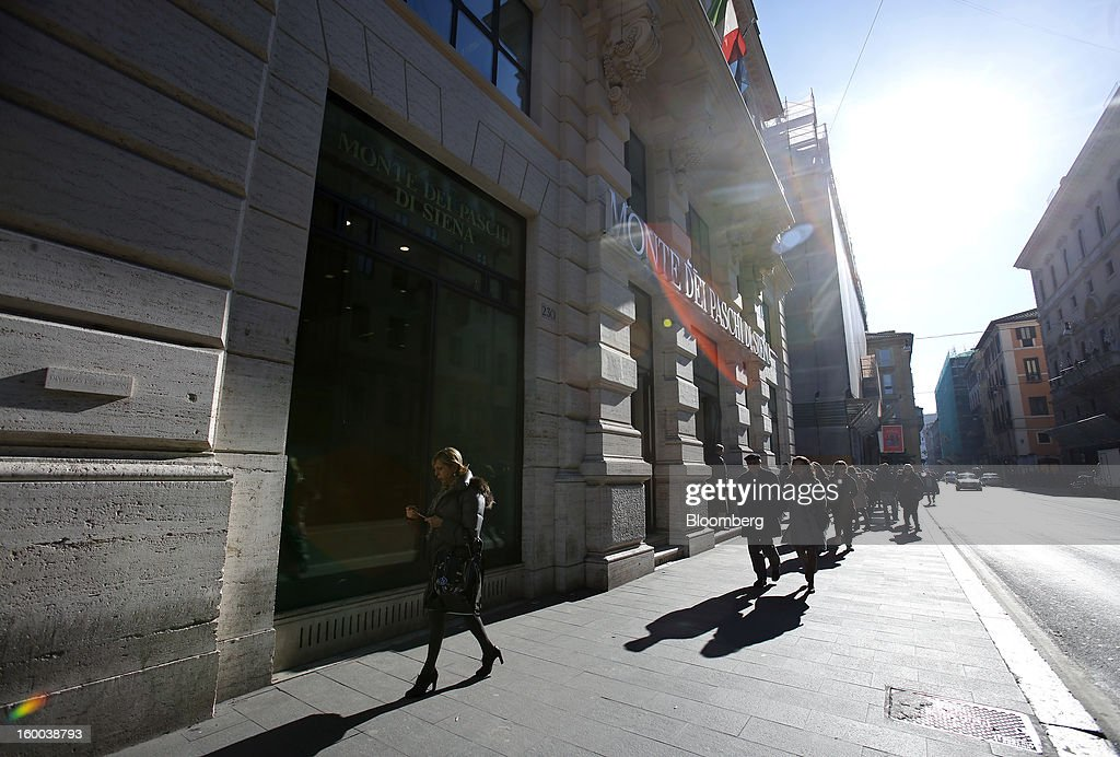 Pedestrians pass a Banca Monte dei Paschi di Siena SpA bank branch in Rome, Italy, on Friday, Jan. 25, 2013. Italian Prime Minister Mario Monti said the Bank of Italy will take another look at Banca Monte dei Paschi di Siena SpA's books after the company disclosed this week it may face more than 700 million euros of losses related to structured finance transactions hidden from regulators. Photographer: Alessia Pierdomenico/Bloomberg via Getty Images