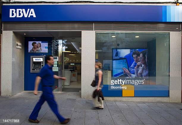 Pedestrians pass a Banco Bilbao Vizcaya Argentaria SA bank branch in Madrid Spain on Friday May 18 2012 Banco Santander SA and Banco Bilbao Vizcaya...