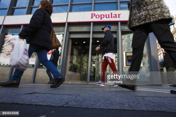 Pedestrians pass a Banco Popular Espanol SA bank branch in Madrid Spain on Friday Feb 10 2017 Banco Populars new Chairman Emilio Saracho will...
