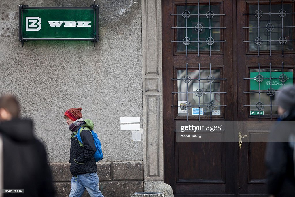 Pedestrians pass a Bank Zachodni WBK SA branch in Wroclaw, Poland, on Monday, March 25, 2013. KBC Groep NV of Belgium and Banco Santander SA of Spain raised 4.89 billion zloty ($1.51 billion) from the sale of a stake in Bank Zachodni WBK SA, Poland's third-largest lender. Photographer: Bartek Sadowski/Bloomberg via Getty Images