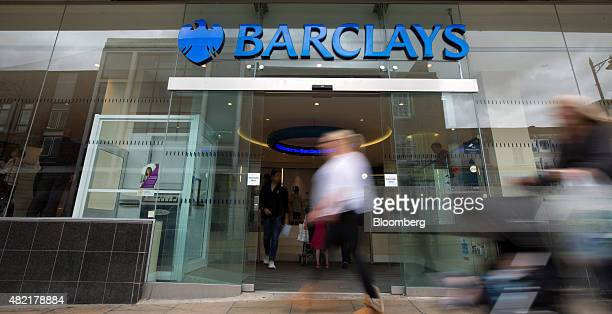 Pedestrians pass a Barclays bank operated by Barclays Plc in Guildford UK on Monday July 2015 Barclays Plc should pick an investment banker as its...