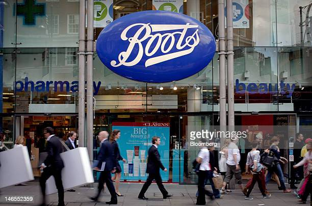 Pedestrians pass a Boots store operated by Alliance Boots in London UK on Tuesday June 19 2012 Walgreen Co the largest US drugstore chain said it...