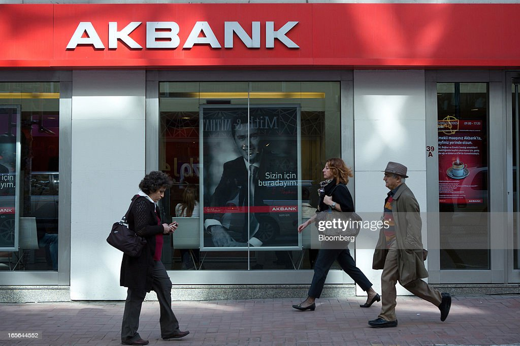 Pedestrians pass a branch of Akbank TAS in the Nisantasi district of Istanbul, Turkey, on Thursday, April 4, 2013. Turkey's gross domestic product expanded 2.2 percent in 2012, down from 8.8 percent the previous year, according to data released by the statistics office in Ankara on April 1. Photographer: Kerem Uzel/Bloomberg via Getty Images