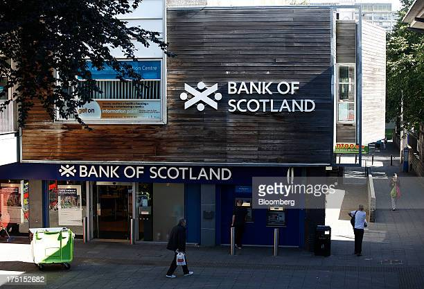 Pedestrians pass a branch of Bank of Scotland Ltd in Edinburgh UK on Wednesday July 31 2013 The latest opinion polls show supporters of Scottish...
