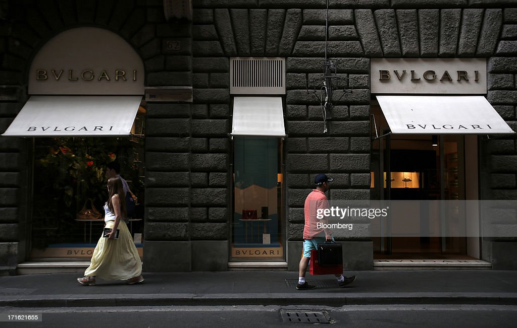 Pedestrians pass a Bulgari SpA store, a luxury unit of LVMH Moet Hennessy Louis Vuitton SA, on Via Condotti in Rome, Italy, on Wednesday, June 26, 2013. Italian household confidence rose this month as consumers grew optimistic about the country's outlook as Prime Minister Enrico Letta's government plans to cut taxes and boost youth employment. Photographer: Alessia Pierdomenico/Bloomberg via Getty Images
