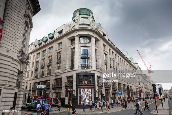 Pedestrians pass a Burberry Group Plc store center as they pass commercial real estate buildings that form part of the Pollen Estate on Regent Street...