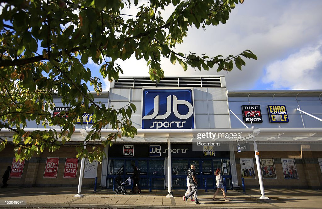 Pedestrians pass a closed down JJB Sports Plc store in Wigan, U.K., on Saturday, Oct. 6, 2012. JJB Sports Plc, a U.K. sporting goods retailer, will close most of its stores with the remaining 20 being acquired by competitor Sports Direct International Plc, according to a statement from KPMG LLP, which was appointed as administrator to the Wigan, England-based company. Photographer: Paul Thomas/Bloomberg via Getty Images