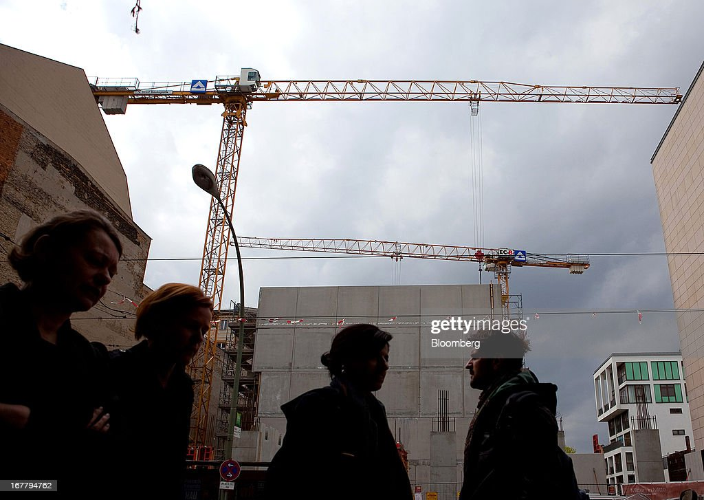 Pedestrians pass a construction site for residential housing located in the Mitte district of Berlin, Germany, on Monday, April 29, 2013. Rents and home prices in Germany's largest cities are rising at the fastest rate in twenty years, according to data compiled by Bulwien Gesa AG. Photographer: Krisztian Bocsi/Bloomberg via Getty Images