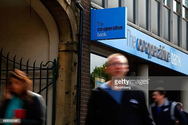 Pedestrians pass a CoOperative Bank Plc branch in Huddersfield UK on Wednesday May 7 2014 Former CoOperative Bank Chairman Paul Flowers was fined 525...