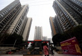 Pedestrians pass a courtyard between highrise apartments in southwest China's Chongqing municipality on January 28 2011 China launched a longawaited...