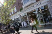 Pedestrians pass a Dartmouth coop store the day before a Republican presidential debate sponsored by Bloomberg via Getty Images and The Washington...