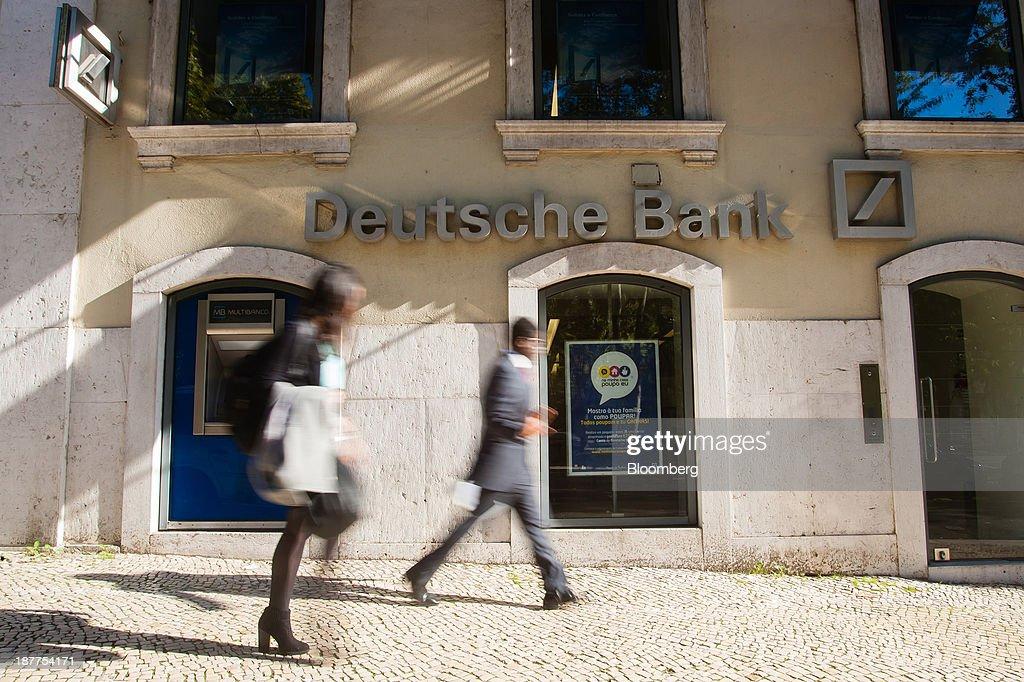 Pedestrians pass a Deutsche Bank AG bank branch in Lisbon, Portugal, on Tuesday, Nov. 12, 2013. Portugal's jobless rate dropped for a second quarter, falling to 15.6 percent in the three months through September as the country's economy shows signs of recovery. Mario Proenca/Bloomberg via Getty Images