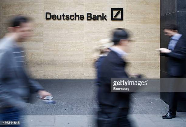 Pedestrians pass a Deutsche Bank logo outside the offices of Deutsche Bank AG in London UK on Monday June 8 2015 John Cryan a supervisory board...