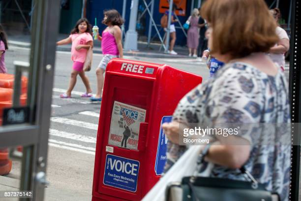 Pedestrians pass a distribution box for The Village Voice in the East Village neighborhood of New York US on Tuesday Aug 22 2017 Peter Barbey owner...