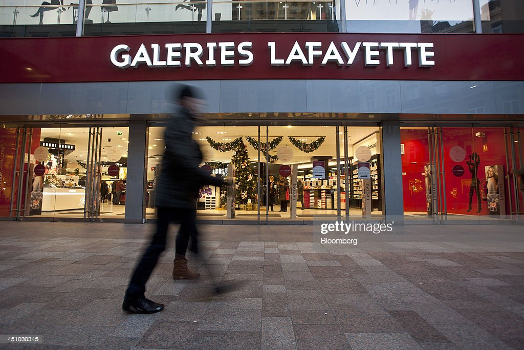 Pedestrians pass a Galleries Lafayette department store in Toulouse, France, on Wednesday, Nov. 20, 2013. France's gross domestic product fell 0.1 percent in the three months through September, national statistics office Insee said in an e-mailed statement. Photographer: Balint Porneczi/Bloomberg via Getty Images