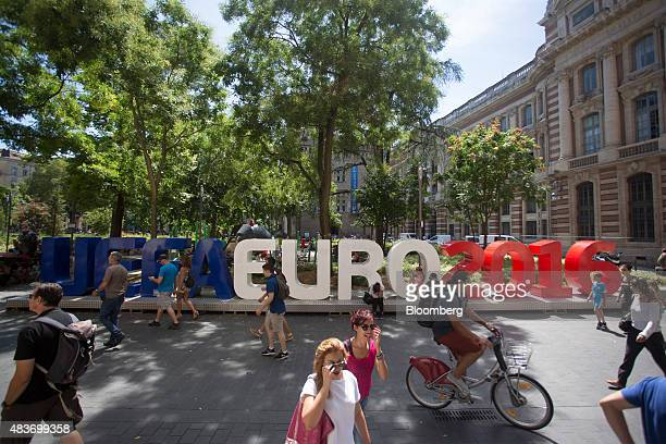 Pedestrians pass a giant logo for UEFA EURO 2016 European soccer tournament in Toulouse France on Tuesday Aug 11 2015 Reports on Friday will probably...