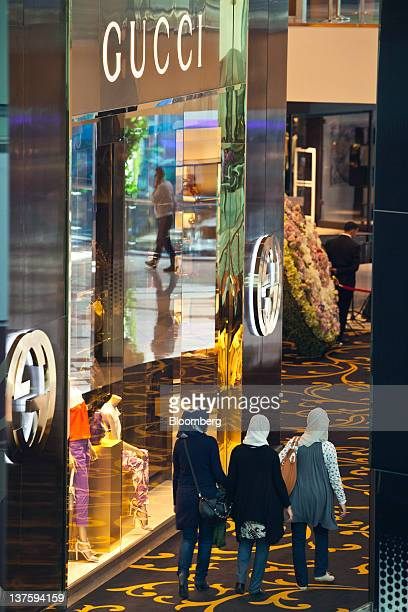 Pedestrians pass a Gucci Group NV store in the VIP zone where the luxury brands are located inside the Morocco Mall in Casablanca Morocco on Friday...
