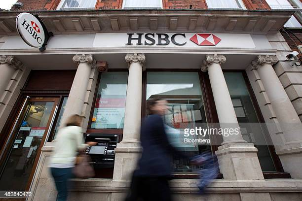 Pedestrians pass a HSBC bank operated by HSBC Holdings Plc in Godalming UK on Monday Aug 3 2015 HSBC Europe's largest bank reported an 18 percent...