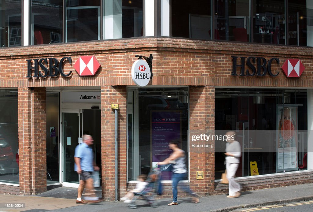 Pedestrians pass a HSBC bank, operated by HSBC Holdings Plc, in Guildford, U.K., on Monday, Aug. 3, 2015. HSBC, Europe's largest bank, reported an 18 percent climb in second-quarter profit amid higher trading income and gains from a sale of shares in China's Industrial Bank Co. Photographer: Jason Alden/Bloomberg via Getty Images