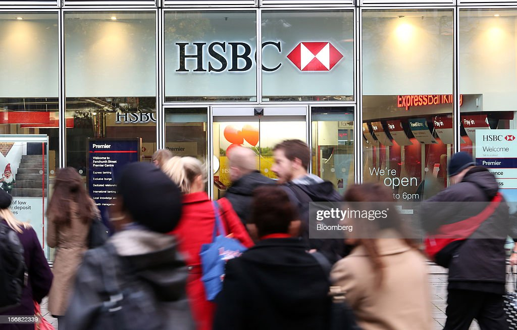 Pedestrians pass a HSBC Holdings Plc bank branch in London, U.K., on Thursday, Nov. 22, 2012. Shares of HSBC have climbed 26 percent this year in London trading, and 30 percent in Hong Kong, as Chief Executive Officer Stuart Gulliver pared costs and sold assets to revive profit and focus on emerging economies in which the bank has a greater market share. Photographer: Chris Ratcliffe/Bloomberg via Getty Images