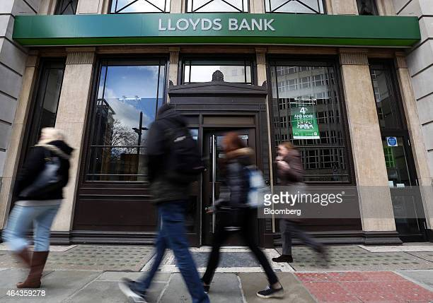 Pedestrians pass a Lloyds Bank branch a unit of Lloyds Banking Group Plc in London UK on Tuesday Feb 24 2015 The UK government sold a further 500...