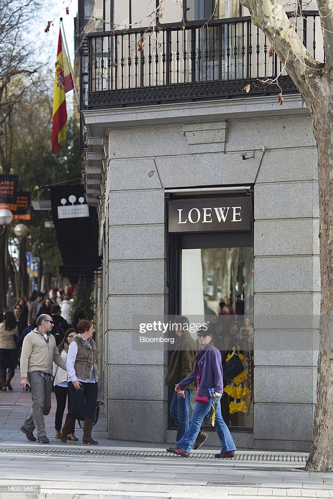 Pedestrians pass a Loewe AG luxury store in Madrid, Spain, on Wednesday, Jan. 30, 2013. Spain's recession deepened more than economists forecast in the fourth quarter as the government's struggle to rein in the euro region's second-largest budget deficit weighed on domestic demand. Photographer: Angel Navarrete/Bloomberg via Getty Images
