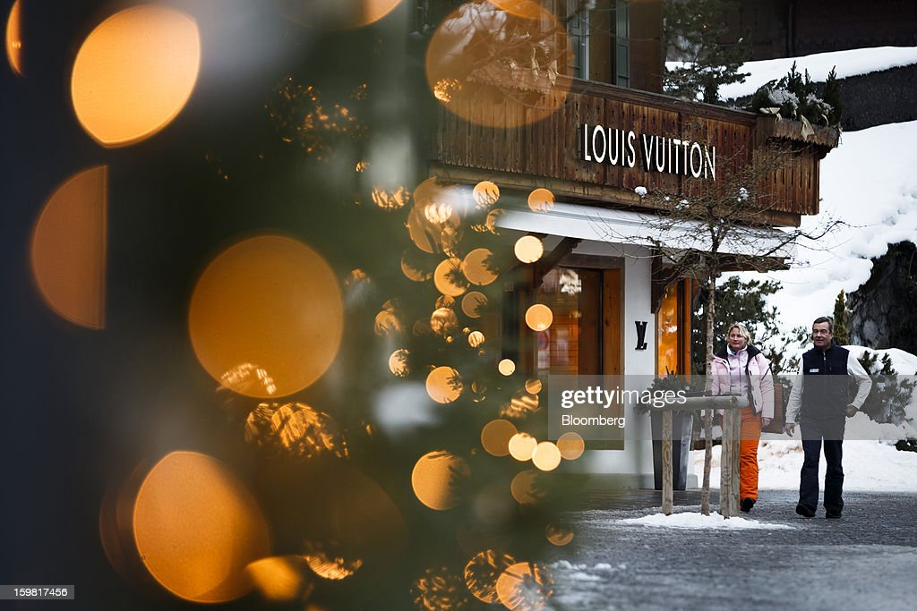 Pedestrians pass a Louis Vuitton store, operated by LVMH Moet Hennessy Louis Vuitton SA, on the promenade in Gstaad, Switzerland, on Saturday, Jan. 19, 2013. Options traders are pushing the cost of bearish wagers on Swiss shares to the lowest level in almost seven years amid optimism a decline in the franc versus the euro will benefit the nation's exporters. Photographer: Valentin Flauraud/Bloomberg via Getty Images