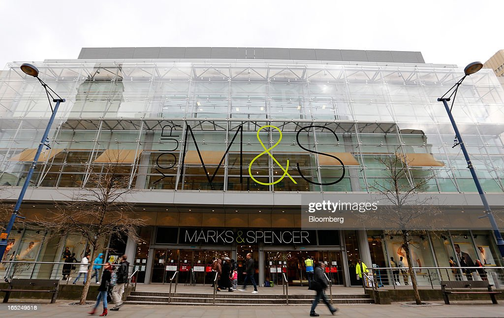 Pedestrians pass a Marks & Spencer Group Plc (M&S) store in Manchester, U.K., on Monday, April 1, 2013. U.K. retail sales unexpectedly stagnated in March in a sign that consumer spending remains under pressure from higher energy bills and weak wage growth. Photographer: Paul Thomas/Bloomberg via Getty Images