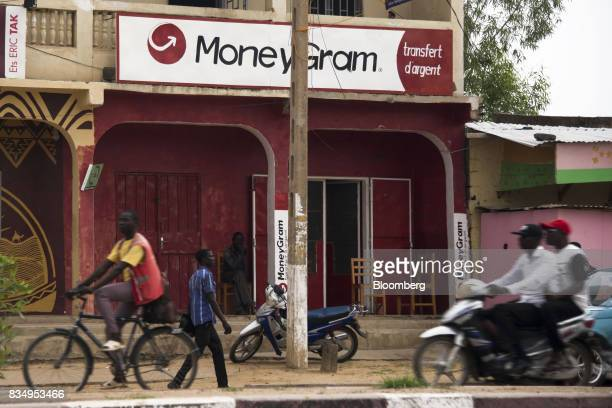 Pedestrians pass a MoneyGram International Inc money transfer store in N'Djamena Chad on Wednesday Aug 16 2017 African Development Bank and nations...