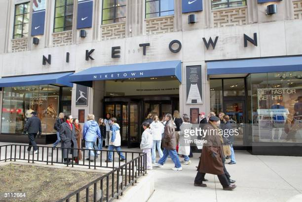 Pedestrians pass a Niketown store March 19 2004 in Chicago illinois Nike Inc reported a 60 percent rise in third quarter net income from the same...
