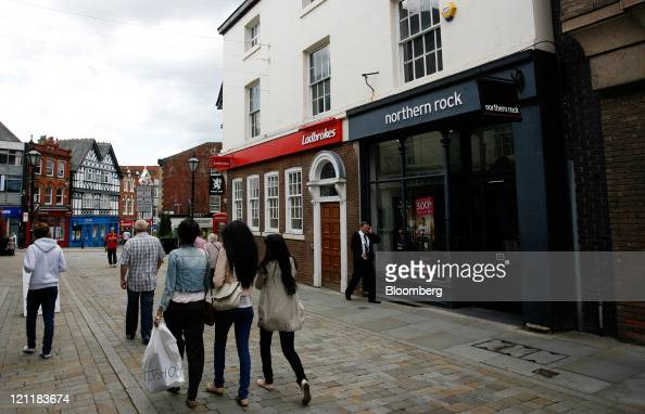 Pedestrians pass a Northern Rock Plc bank branch in Stockport UK on Monday Aug 15 2011 Northern Rock Plc a unit of the nationalized UK bank that's up...