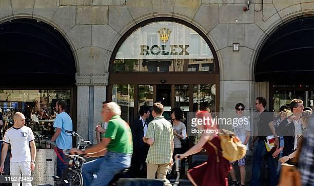 Pedestrians pass a Rolex store at the Amsterdam Diamond Center in Amsterdam Netherlands on Friday June 3 2011 The Dutch economy grew 09 percent in...