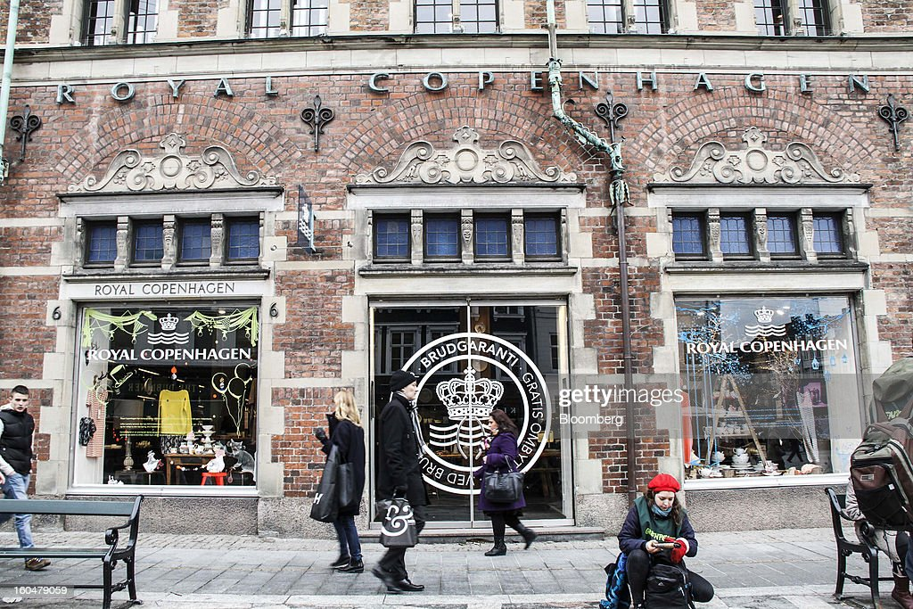 Pedestrians pass a Royal Copenhagen store selling Danish porcelain on Storget street in Copenhagen, Denmark, on Friday, Feb. 1, 2013. Danish regional banks are struggling to emerge from a burst property bubble that's forced the government resolution agency to take over a dozen lenders after losses on commercial and agricultural loans wiped out capital. Photographer: Freya Ingrid Morales/Bloomberg via Getty Images