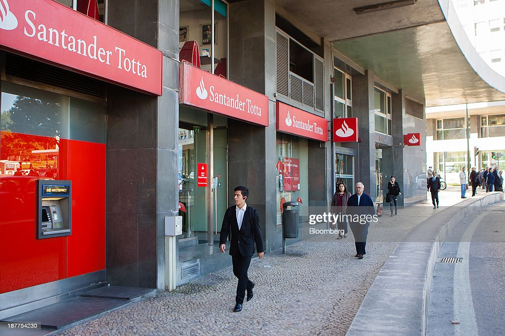 Pedestrians pass a Santander Totta SA bank branch in Lisbon, Portugal, on Tuesday, Nov. 12, 2013. Portugal's jobless rate dropped for a second quarter, falling to 15.6 percent in the three months through September as the country's economy shows signs of recovery. Mario Proenca/Bloomberg via Getty Images