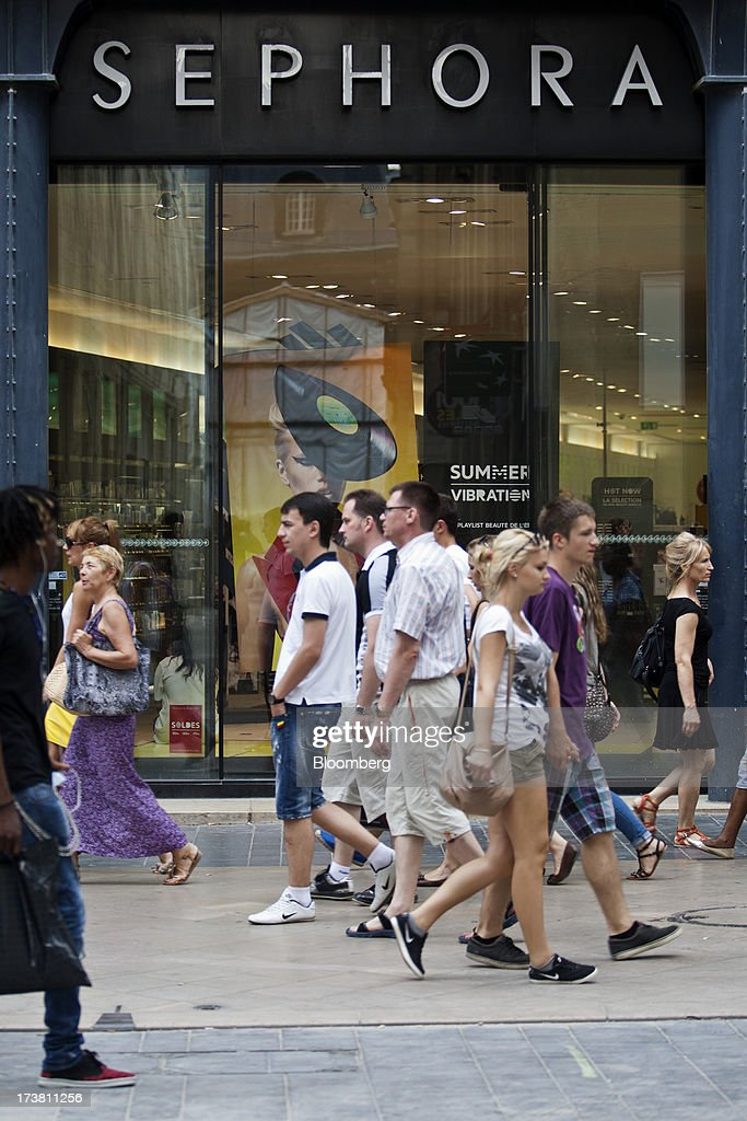 Pedestrians pass a Sephora SA cosmetics store, operated by LVMH Moet Hennessy Louis Vuitton, in Bordeaux, France, on Wednesday, July 17, 2013. Austerity measures and rising unemployment are restraining consumer spending in Europe, while retailers including Groupe Auchan SA and Casino Guichard-Perrachon SA are competing more aggressively on price. Photographer: Balint Porneczi/Bloomberg via Getty Images