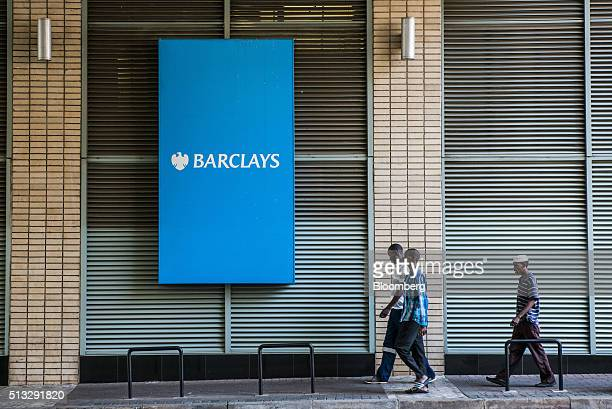 Pedestrians pass a sign outside the offices of Barclays Plc bank in Johannesburg South Africa on Wednesday March 2 2016 The South African Reserve...