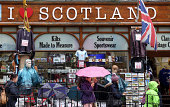 Pedestrians pass a souvenir shop on the Royal Mile in Edinburgh UK on Saturday Sept 20 2014 Prime Minister David Cameron vowed to give English...
