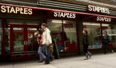 Pedestrians pass a Staples store November 14 2006 in New York City Driven by strong backtoschool sales Staples Inc the nation's largest office...