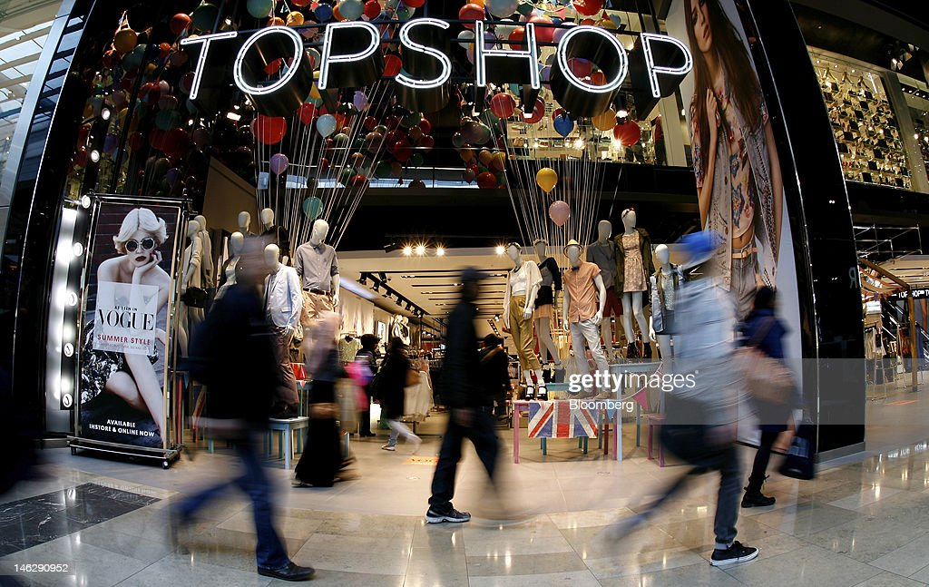 Pedestrians pass a Topshop store at the Westfield Stratford City mall, operated by Westfield Group, in London, U.K., on Tuesday, June 12, 2012. London Olympics organizers raised more than 700 million pounds ($1.1 billion) in domestic sponsorship, including from shopping mall-owner Westfield Group, British Airways and BT Group Plc. Photographer: Paul Thomas/Bloomberg via Getty Images