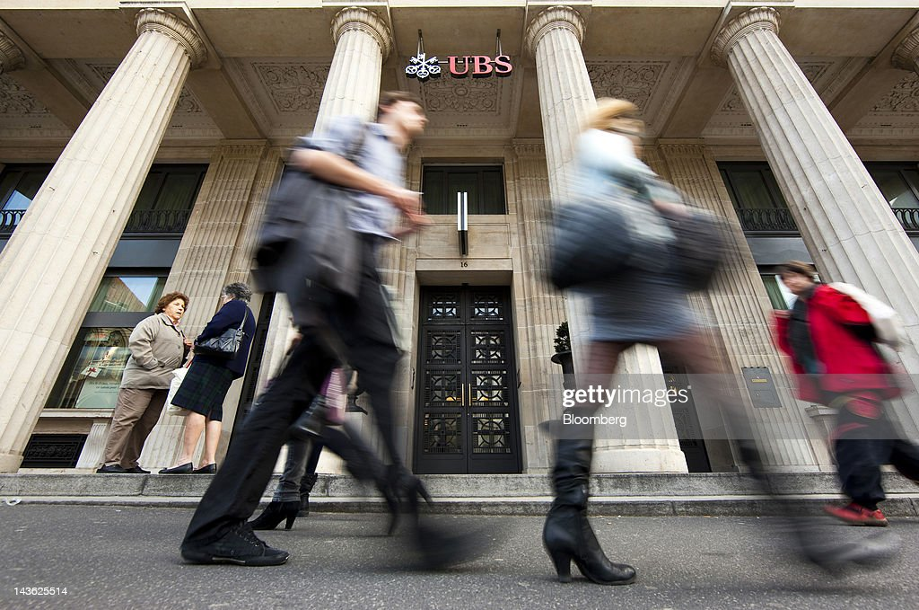 Pedestrians pass a UBS AG bank branch in Lausanne, Switzerland, on Monday, April 30, 2012. UBS AG will post first quarter earnings earnings on May 2. Photographer: Valentin Flauraud/Bloomberg via Getty Images