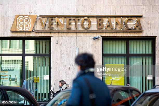 Pedestrians pass a Veneto Banca SpA bank branch in Rome Italy on Friday Dec 23 2016 The nationalization of Banca Monte dei Paschi di Siena SpA could...