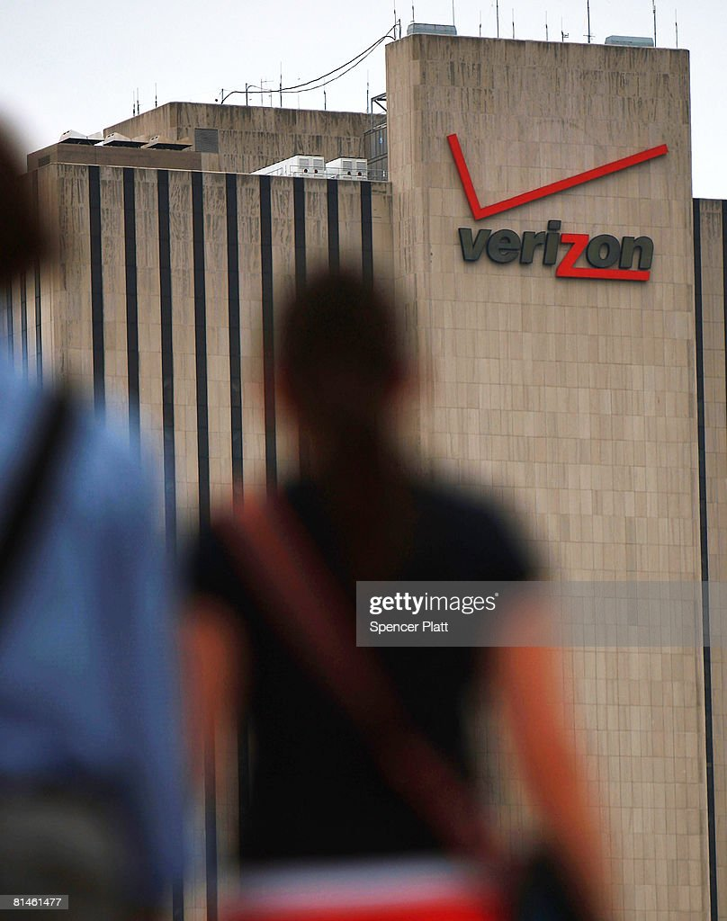 Pedestrians pass a Verizon logo on a building June 5, 2008 in New York City. Verizon Wireless has confirmed its acquisition of rural mobile service provider Alltel for $28.1 billion, a deal which will push Verizon into number one spot in the US market.