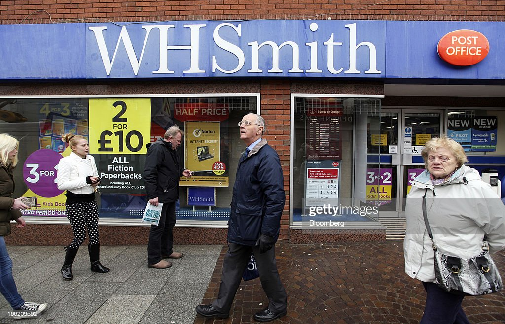 Pedestrians pass a WH Smith Plc store in Folkestone, U.K., on Tuesday, April 9, 2013. WH Smith Plc, the book and magazine retailer with more than 1,100 U.K. outlets, is scheduled to announce earnings on April 11. Photographer: Chris Ratcliffe/Bloomberg via Getty Images