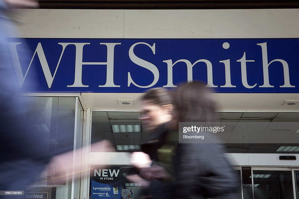 Pedestrians pass a WH Smith Plc store in London, U.K., on Wednesday, April 10, 2013. WH Smith Plc, the book and magazine retailer with more than 1,100 U.K. outlets, is scheduled to announce earnings on April 11. Photographer: Simon Dawson/Bloomberg via Getty Images