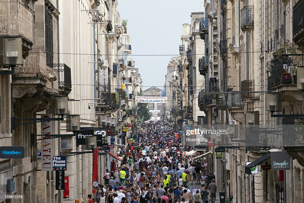 Pedestrians pass along Rue Sainte-Catherine, the main shopping street in Bordeaux, France, on Wednesday, July 17, 2013. Austerity measures and rising unemployment are restraining consumer spending in Europe, while retailers including Groupe Auchan SA and Casino Guichard-Perrachon SA are competing more aggressively on price. Photographer: Balint Porneczi/Bloomberg via Getty Images
